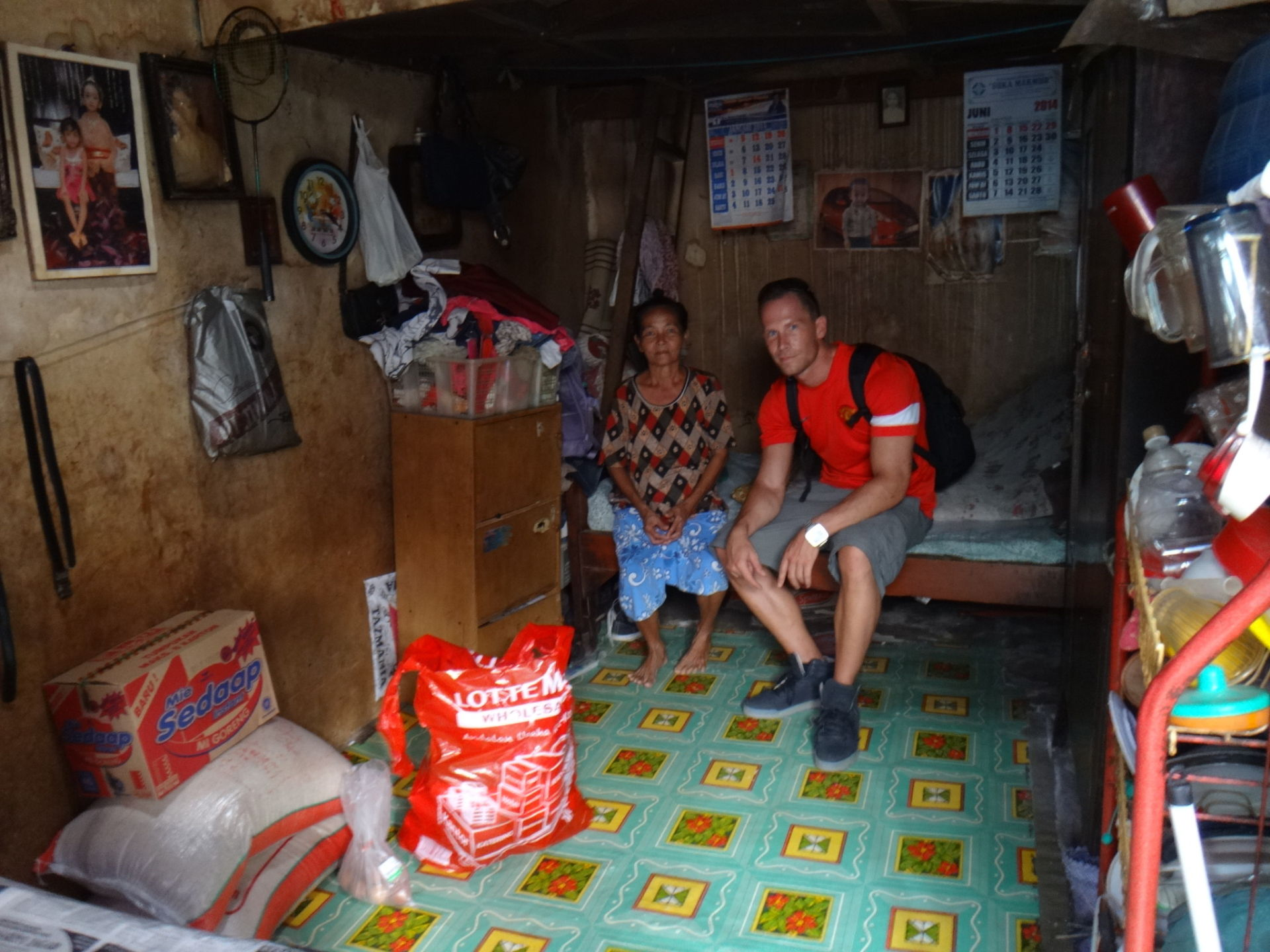 In June of 2014 Feed Staring People did it's first mission in Java, Indonesia. We went to a very poor part of a town in Solo. Locals, Christine Marie and Anggus, guided us to this family. Tim sat and prodded this 60+ year old woman with questions to find out the depth of this families struggles.