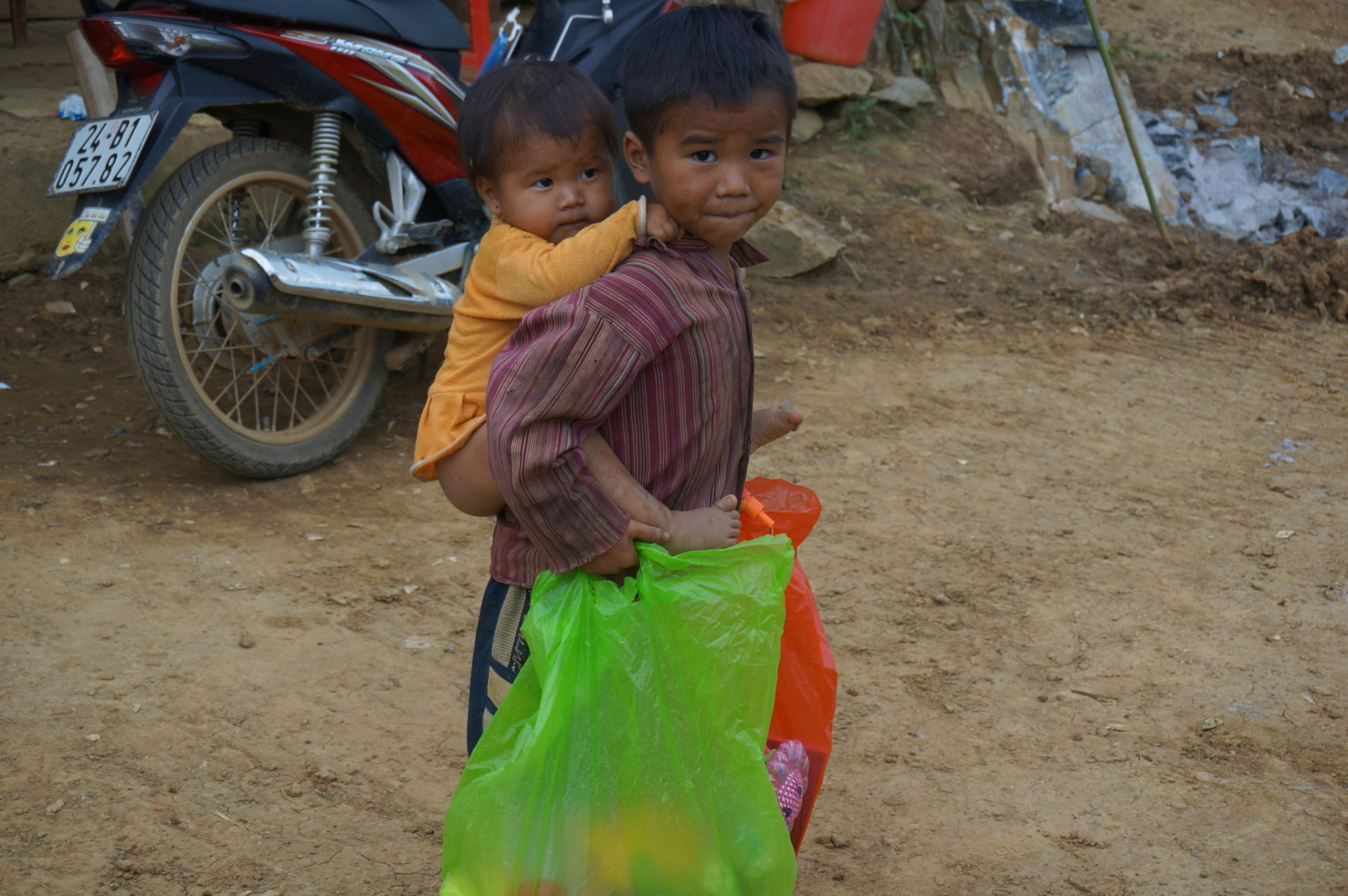 It costs just a couple dollars to give each one of these children in the northern mountains of Si Ma Cai, Vietnam a bag full of clothes, shoes, and school supplies.