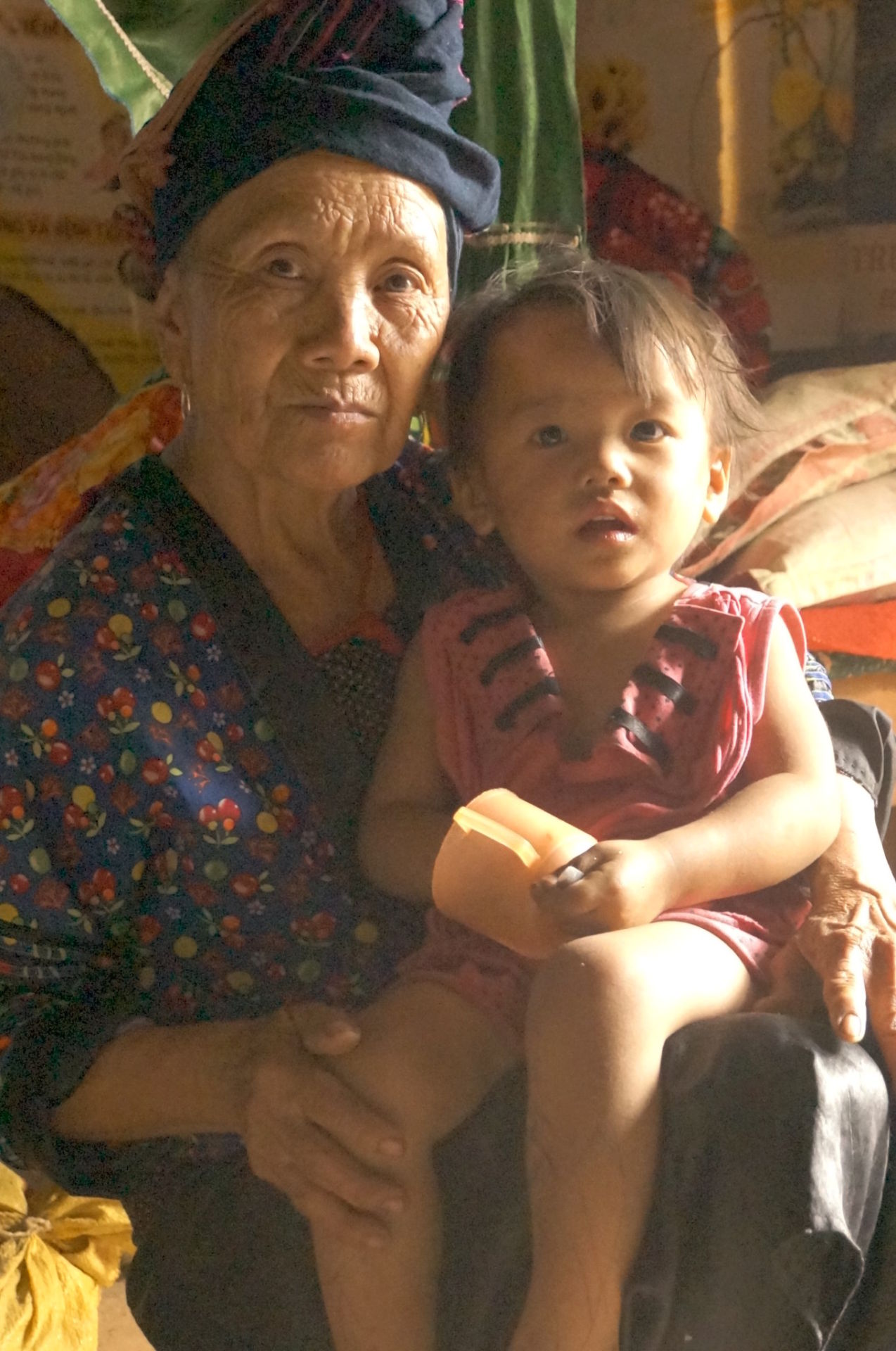 This 72 year old woman lives alone here and raises her grand daughter. She works 8-10 hour days for less than a dollar a day! Son La Province, Northern Vietnam.