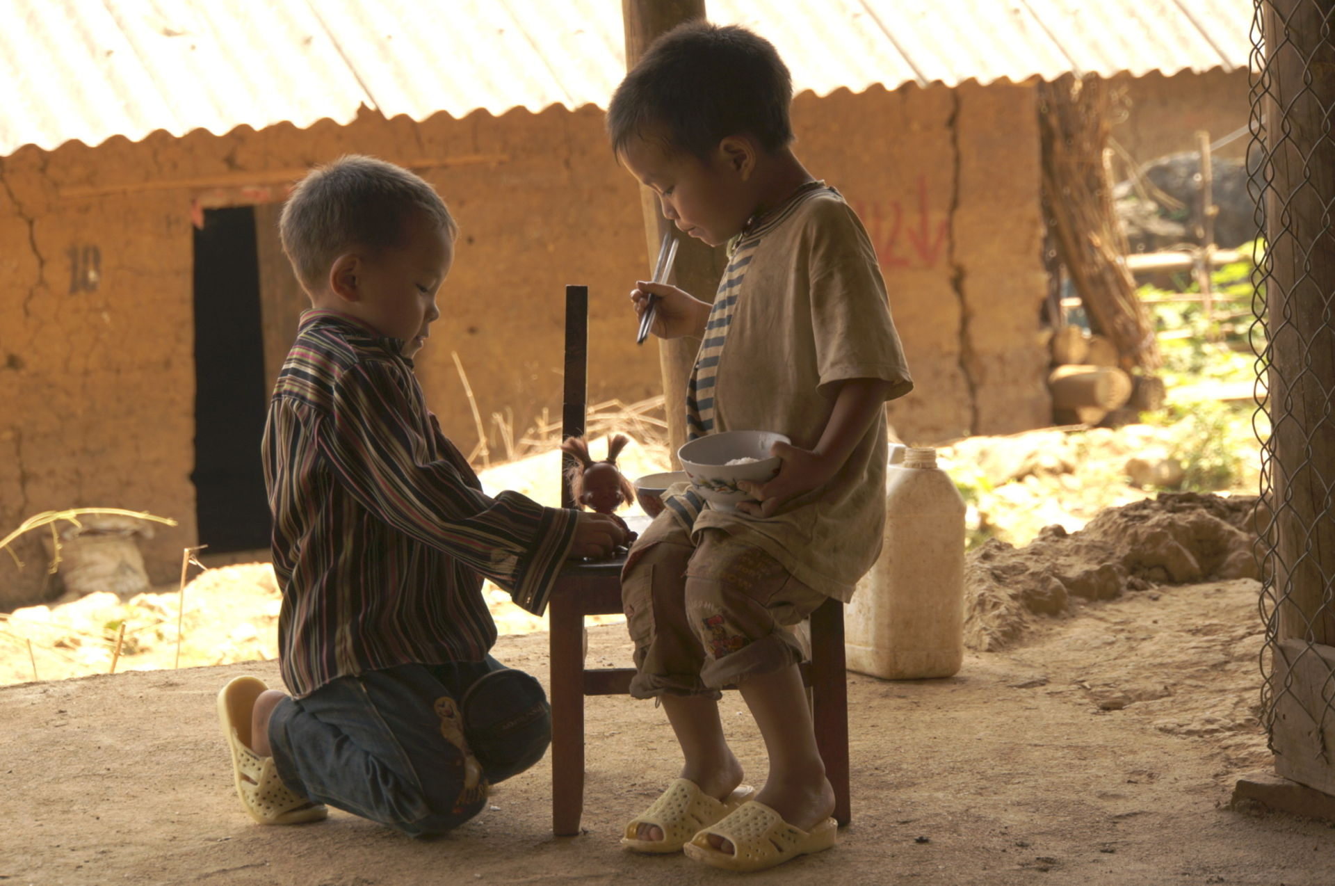 Watching these kids put on new shoes and eat a fresh bowl of soup together is a precious moment along the way!