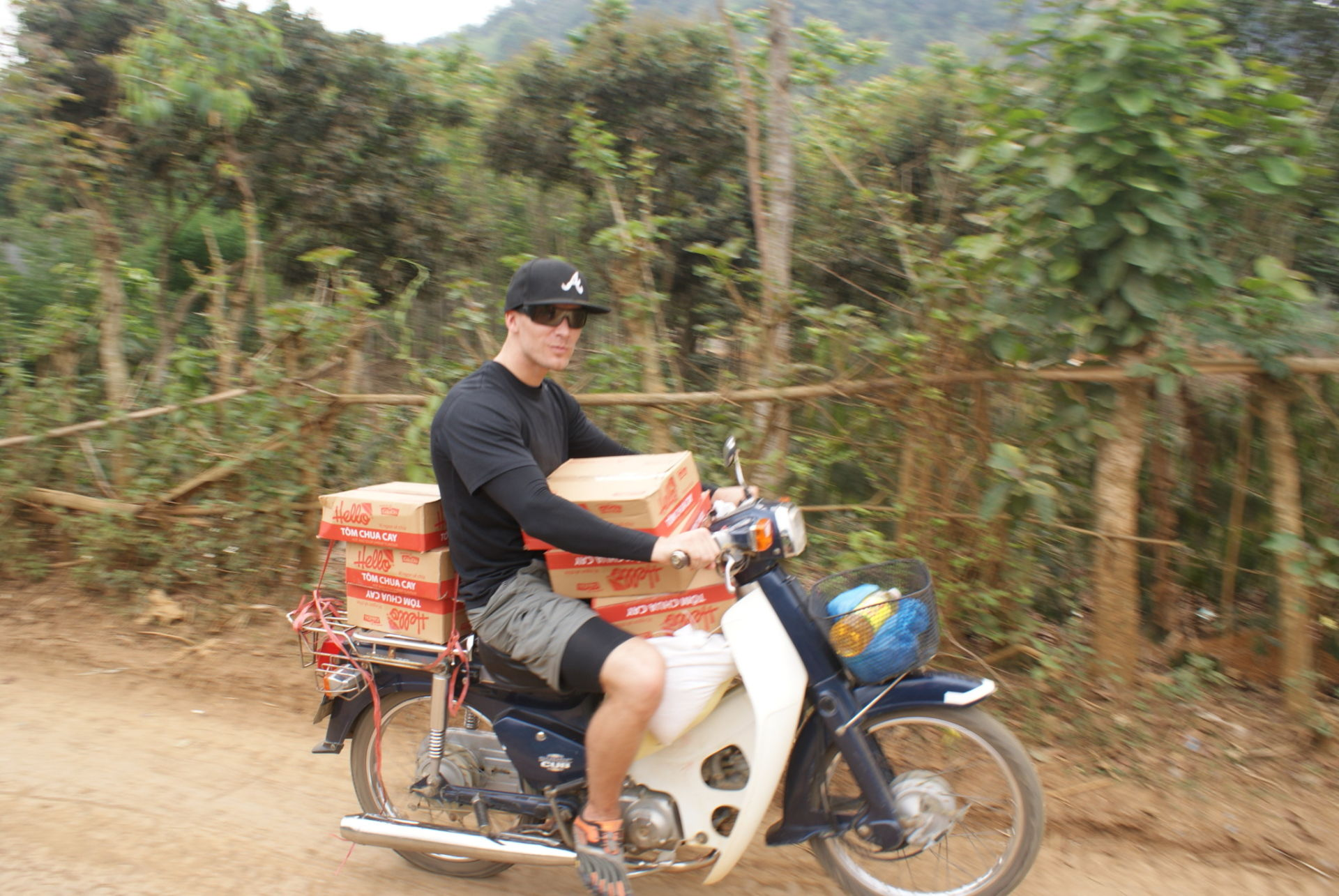 Riding on a motorbike dropping off food at poor families doorsteps like Santa Clause. Probably the coolest thing I've ever done. Feed starving people hopes to inspire others to do this. We will show you how... just contact us!