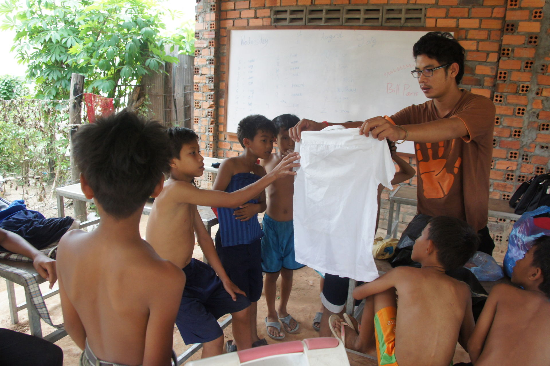 Handing out new clothes to 27 kids at the Best Way for Children Organization orphanage.