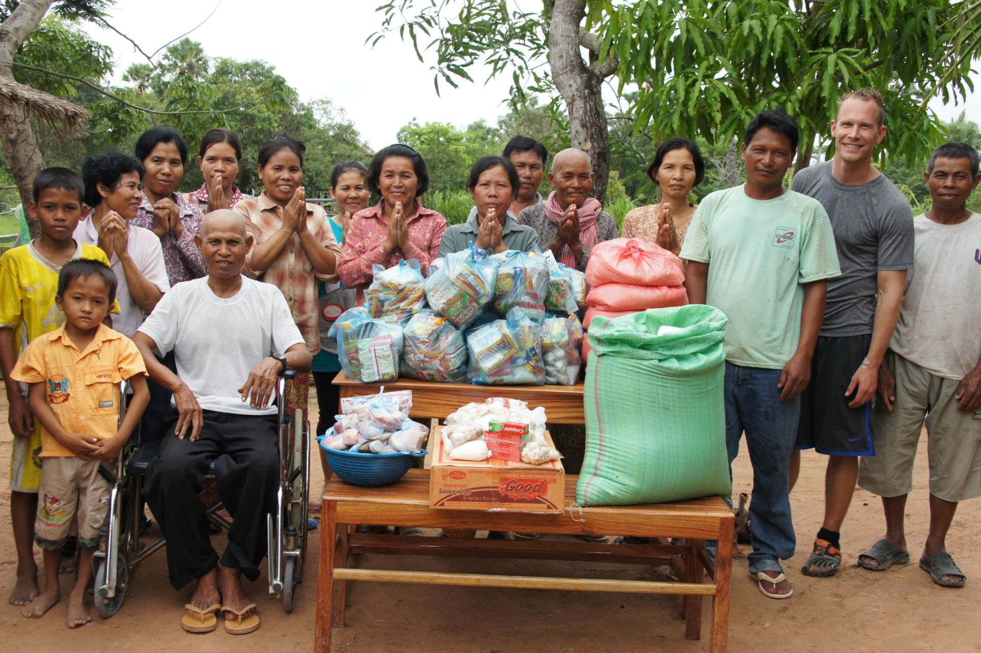 Giving food to 15 families an hour and a half outside of Siem Reap, Cambodia. It's amazing how they all work peacefully together to divide it all up evenly, making sure everyone gets an even share.