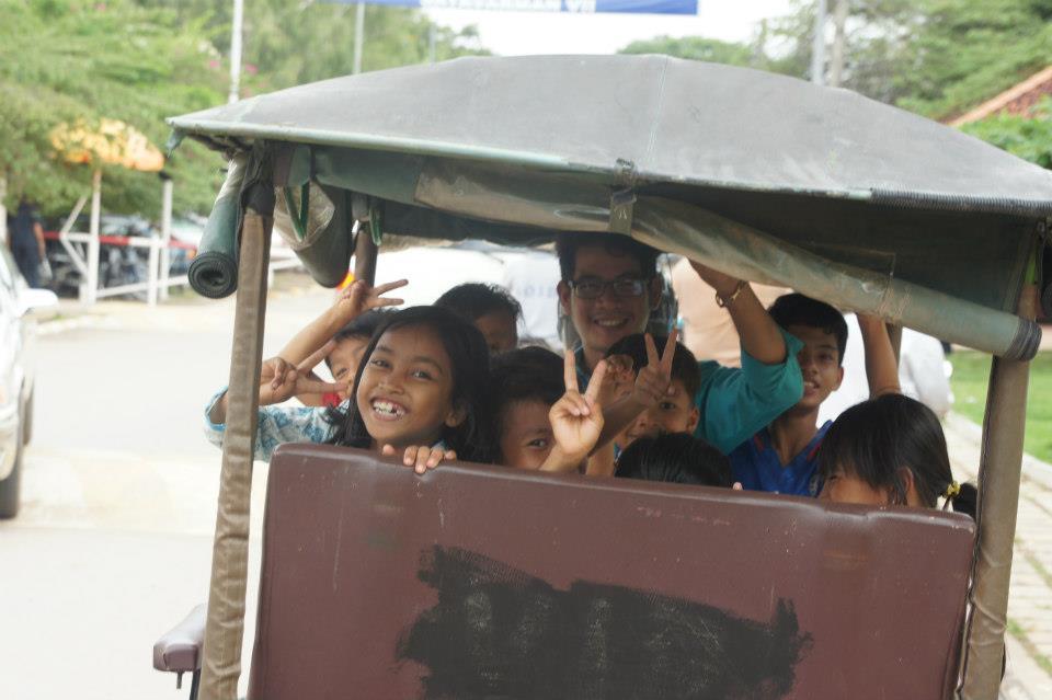 Happy kids in a Tuk Tuk.