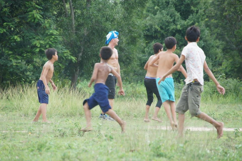 Playing soccer with the kids.