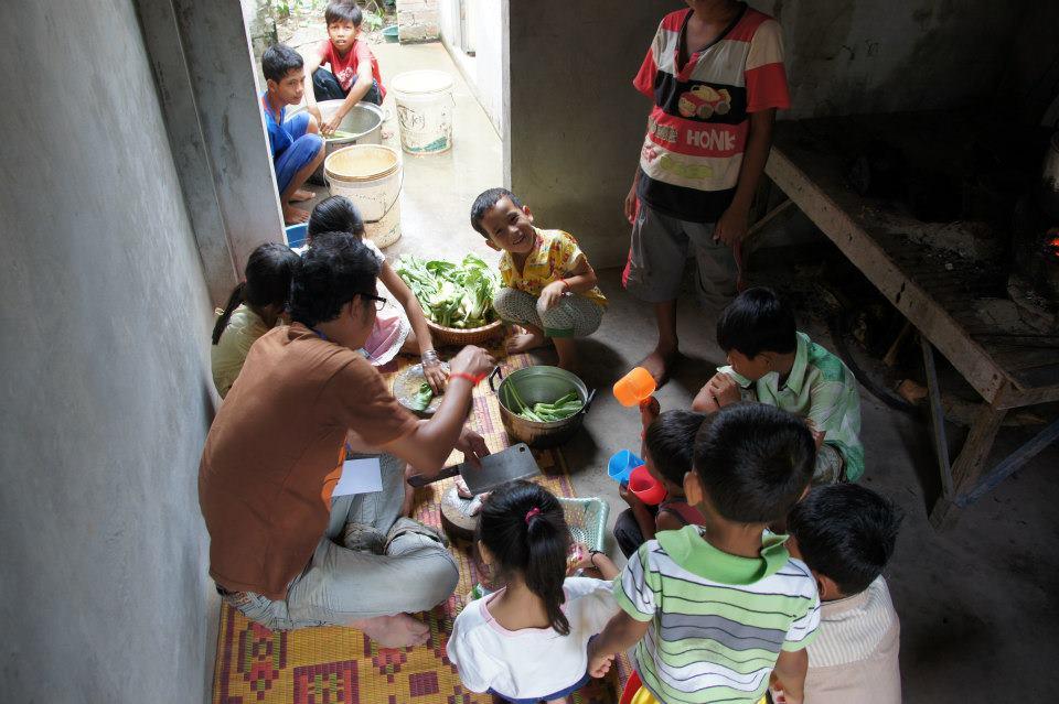 Preparing food at the orphanage.
